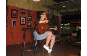 Riel Hahn performs a song at Komedy at Kino.