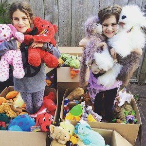 "Fourth Graders Luca Capicik and Nicole McLeod went door to door and collected more than 200 stuffed animals for children from Syria in their ""Me to We"" project."